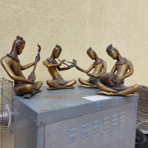 4 brass musicians each musician 13 inches high